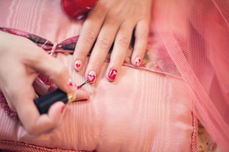painting-fingernails-nail-polish-hearts-valentine-37553.jpeg