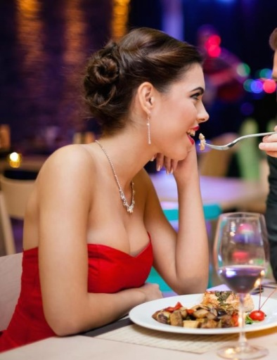 man-and-woman-dressed-nicely-eating-at-restaurant.jpg
