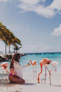 girl-with-flamingos-200x300