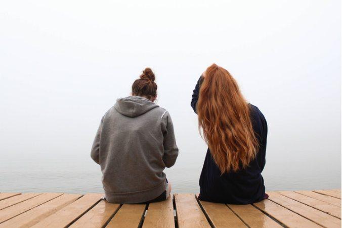 Two women on a dock.