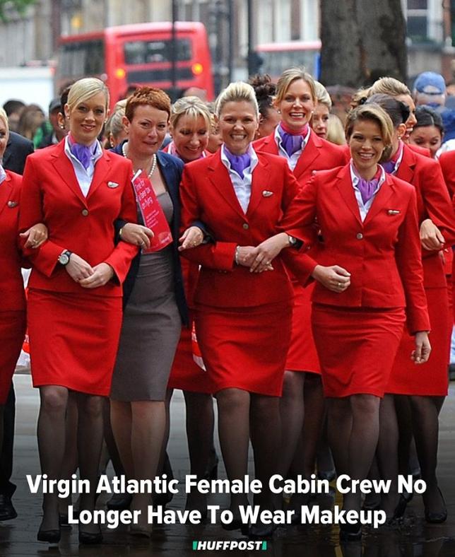 Female Virgin Atlantic flight attendants walking arm in arm.
