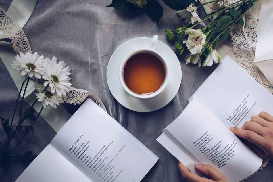 A girl reading poetry with a cup of tea